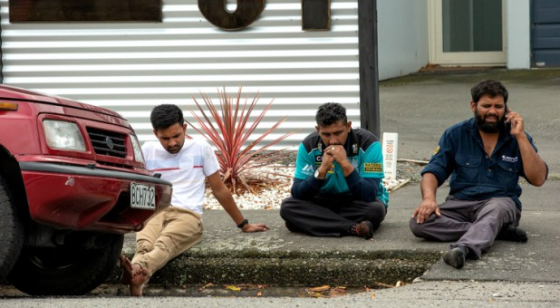 Grieving members of the public following a shooting at the Al Noor mosque in Christchurch.