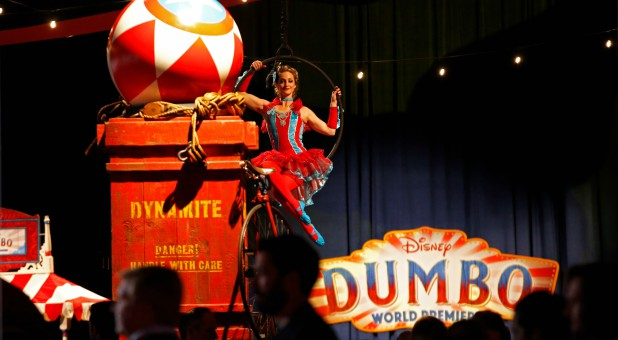 "A performer provides entertainment at the premiere for the movie ""Dumbo."""