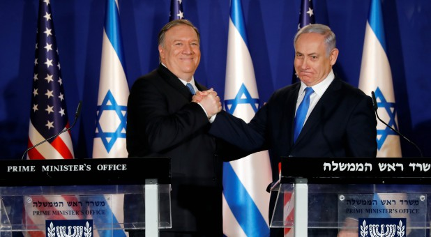 U.S. Secretary of State Mike Pompeo shakes hands with Israeli Prime Minister Benjamin Netanyahu