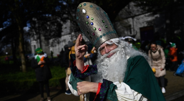 A man dressed as St. Patrick participates in the St. Patrick's Day parade in Galway, Ireland.