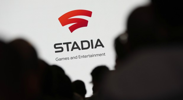 Spectators look on during a Google keynote address announcing a new video gaming streaming service named Stadia.