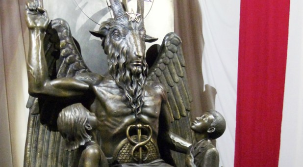 A one-ton, 7-foot (2.13-m) bronze statue of Baphomet—a goat-headed winged deity that has been associated with Satanism and the occult—is displayed by the Satanic Temple.