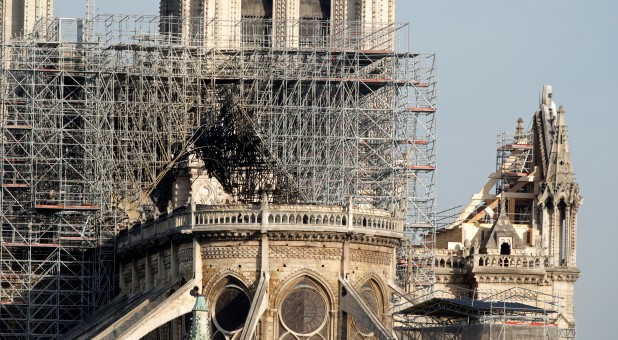 View of the rear of Notre Dame Cathedral after a massive fire devastated large parts of the Gothic structure in Paris, France.