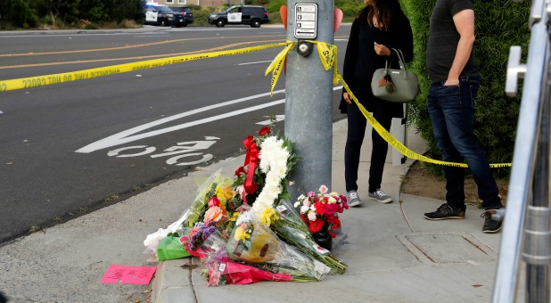 A makeshift memorial is placed by a light pole a block away from a shooting incident where one person was killed at the Congregation Chabad synagogue in Poway, north of San Diego, California.