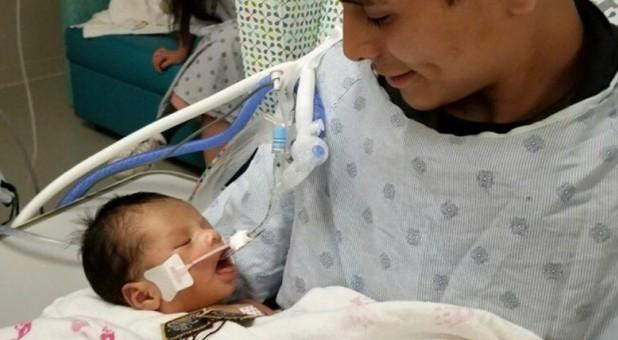 Yovani Lopez with baby Yadiel