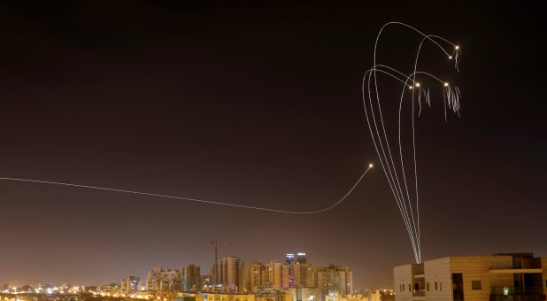 Iron Dome anti-missile system fires interception missiles as rockets are launched from Gaza toward Israel as seen from the city of Ashkelon, Israel.
