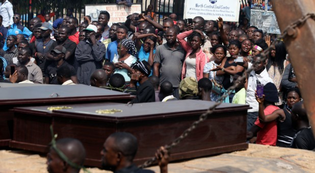 People react as a truck carries the coffins of people killed by the Fulani herdsmen, in Makurdi, Nigeria.