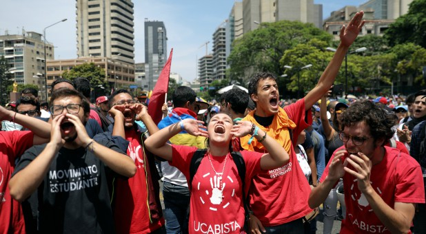 Supporters of Venezuelan opposition leader Juan Guaido, whom many nations have recognized as the country's rightful interim ruler, chant slogans as they take part in a rally against the government of Venezuela's President Nicolas Maduro.