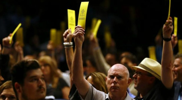 Messengers vote in favor on the amendment of SBC Constitution Article III, Section 1, on sexual abuse during the annual meeting of the Southern Baptist Convention.