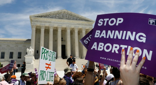 Abortion rights activists rally outside the U.S. Supreme Court.