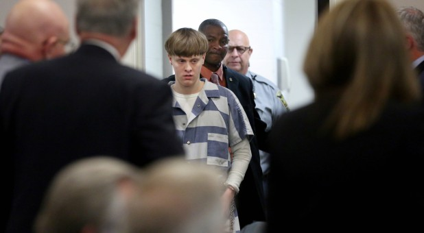 Dylann Roof is escorted into the courtroom at the Charleston County Judicial Center to enter his guilty plea on murder charges in state court for the 2015 shooting massacre at a historic black church, in Charleston, South Carolina.
