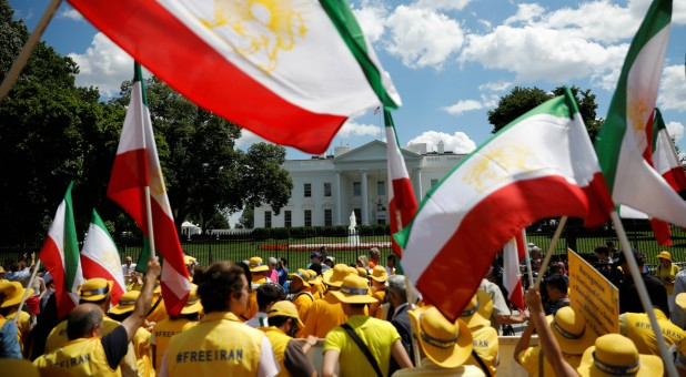 "Activists hold an ""Uprising for Regime Change"" rally and ""solidarity march with the Iranian resistance"" outside the White House."