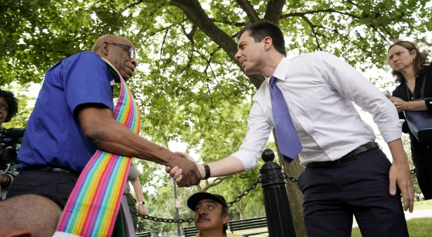 2020 Democratic U.S. presidential candidate South Bend Mayor Pete Buttigieg greets an activist as he attends a rally in protest against the Trump administration.