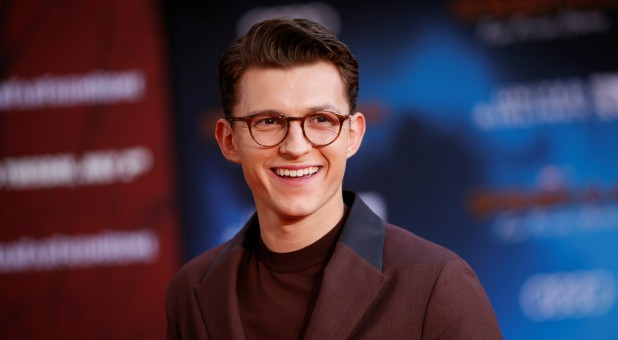 "Actor Tom Holland poses at the World Premiere of Marvel Studios' ""Spider-man: Far From Home"" in Los Angeles, California."