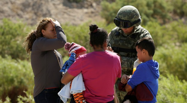 Honduran migrants are stopped by a member of the Mexican National Guard in Anapra, on the outskirts of Ciudad Juarez, Mexico.