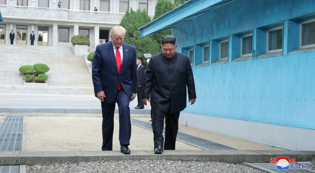U.S. President Donald Trump and North Korean leader Kim Jong Un cross over a military demarcation line at the demilitarized zone (DMZ) separating the two Koreas, in Panmunjom, South Korea.