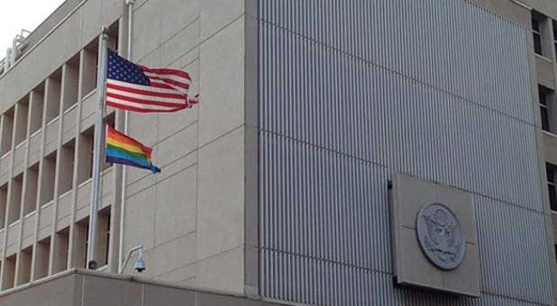 The U.S. Embassy in Tel Aviv flies the LGBT pride flag beneath the American flag in a recent photo uploaded to Facebook.