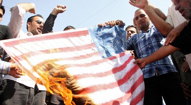 radical islamists burn american flag