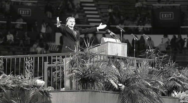Billy Graham preaches at a crusade in Birmingham, Alabama.