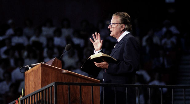 'Billy Graham at a crusade in Oklahoma City.' from the web at 'http://www.charismanews.com/images/stories/2015/featured-news/Billy-Graham-OK-Crusade.jpg'