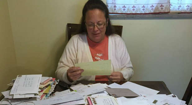 Kentucky governor orders clerks' names removed from marriage licenses at the center of a controversy involving clerk Kim Davis.