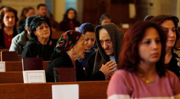 Iraqi Christians attend mass.