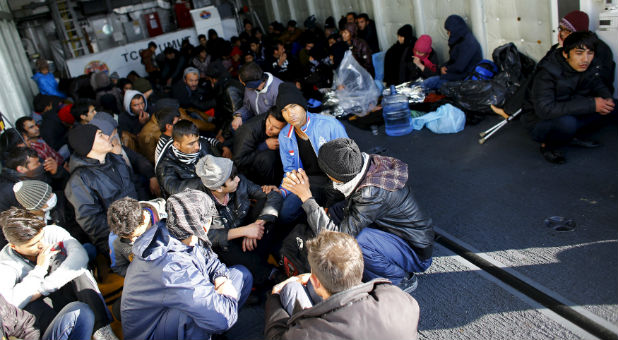 Migrants wait to meet with the Coast Guard outside Greece.
