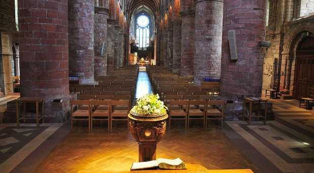 An altar and baptismal font in an Anglican church.