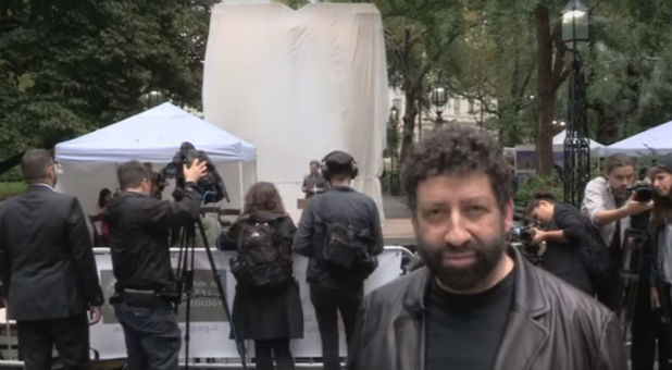Jonathan Cahn in front of the replica Baal arch.