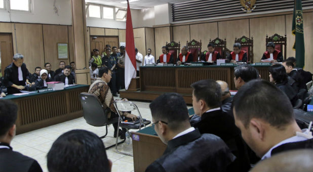 Jakarta Governor Basuki Tjahaja Purnama, popularly known as Ahok, sits on the defendant's chair at the start of his trial hearing at North Jakarta District Court in Jakarta, Indonesia