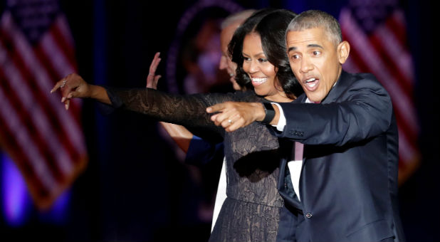 U.S. President Barack Obama and his wife Michelle acknowledge the crowd after President Obama delivered a farewell address