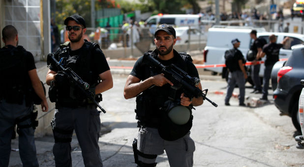 Israeli riot policemen secure the area following a shooting incident in what an Israeli police spokesperson described as a terrorist attack, in Sheikh Jarrah in East Jerusalem Oct. 9, 2016.