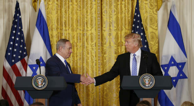 U.S. President Donald Trump (R) greets Israeli Prime Minister Benjamin Netanyahu after a joint news conference at the White House in Washington, D.C., Feb. 15, 2017.