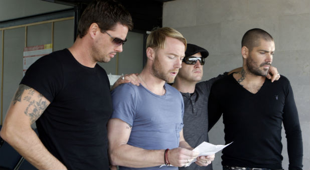 Boyzone members (L-R) Keith Duffy, Ronan Keating, Mikey Graham and Shane Lynch read a statement honoring their friend and fellow band member Stephen Gately, at Son Sant Joan airport in Palma de Mallorca October 16, 2009.