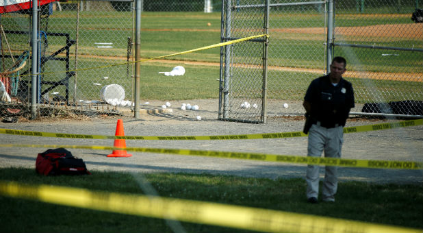 A police officer mans a shooting scene after a gunman opened fire on Republican members of Congress during a baseball practice near Washington in Alexandria, Virginia..