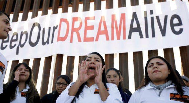 """Dreamers"" react as they meet with relatives during the ""Keep Our Dream Alive"" binational meeting at a new section of the border wall on the U.S.-Mexico border."
