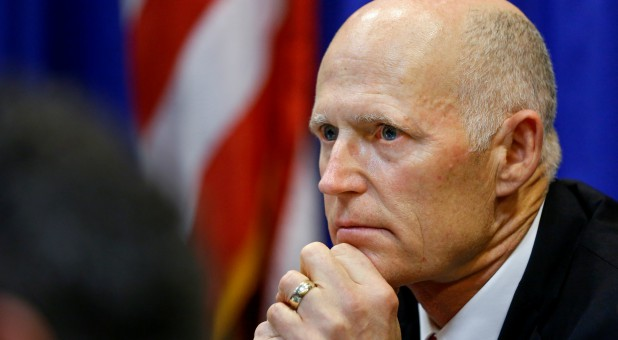 Florida Governor Rick Scott listens during a meeting with law enforcement, mental health and education officials about how to prevent future tragedies in the wake of last week's mass shooting at Marjory Stoneman Douglas High School.